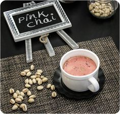 The tea is prepared with Kashmiri tea leaves or green tea leaves, milk and salt. Usually, noon chai is served with nuts in Pakistan. A pinch of baking soda is added to give a rich variant of pink color.