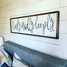 Truly. Madly. Deeply. Bedroom sign but portrait above night stand
