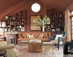 In an upstate New York house, a contemporary room with a cathedral ceiling — an addition ill-suited to the house — was transformed into a cozy, barn-like family room.