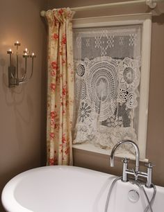 Janet Clare - bathroom curtain - lots and lots of doilies sewn together