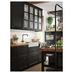Excellent modern kitchen room are available on our site. look at this and you wont be sorry you did. Black Kitchen Cabinets, Kitchen Cabinet Colors, Black Kitchens, Home Kitchens, Kitchen With Black Appliances, Ikea Kitchens, Kitchen With Wood Countertops, Kitchen Cabinets Designs, Black Countertops White Cabinets
