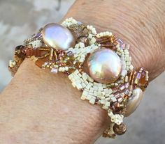Free form beaded bracelet in creams and golds with multiple