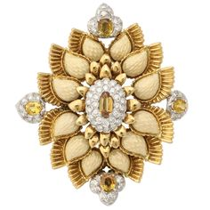 1970s Cartier Yellow Enamel Citrine Diamond Gold Floral Pendant | From a unique collection of vintage brooches at https://www.1stdibs.com/jewelry/brooches/brooches/