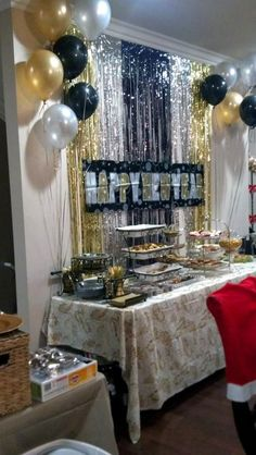 Party Decor for New Years Eve Put the hanging glitter and a banner behind the band