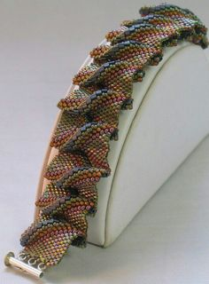 Beaded bracelet. Very clever use of Cellini spiral, flat. Notice the under ruffle...