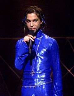 1999  -   In blue leather and beaded braids, Prince hits the stage at the MTV Video Music Awards at Metropolitan Opera House in New York in September 1999.