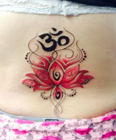Pink lotus flower lower back tattoo! Ohm at the top represents harmony and peace with the universe! I love it!!!