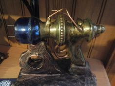 This raygun is made from metal parts, resin and a rare glass piece