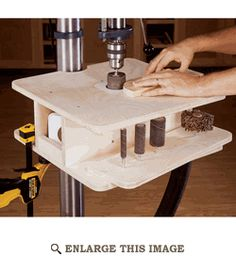 Drill press table with a knockout and enough depth in box below to do edge sanding with drum sanding bits.