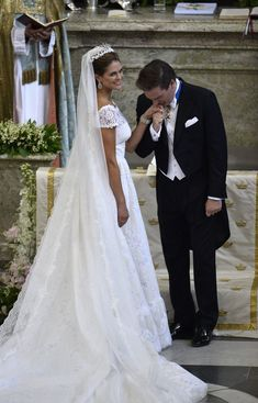 Christopher O'Neill kisses the hand of his bride Princess Madeleine of Sweden during their wedding ceremony at The Royal Palace on 8 June 2013 in Stockholm, Sweden.