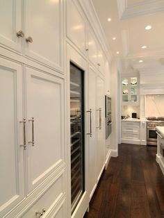 Floor to ceiling cabinets. White on white.