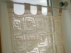 knitted lace curtains for lots of light and just a bit of privacy.  I'm picturing these in a fresh, light green or blue.