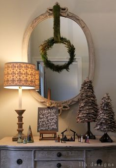 LLH DESIGNS: The Weightiness of Christmas--love the wreath on the mirror...