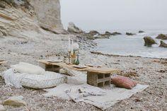 minimal bohemian dinner spot on the beach