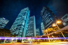 Asia Business concept for real estate and corporate construction - looking up night view in road intersection of shinjuku, the silhouettes of skyscrapers reflect twilight sky in Tokyo, Japan , Twilight Sky, Financial News, In 2019, Negative Space, Looking Up, Photo Editing, Asia, Royalty Free Stock Photos, Real Estate