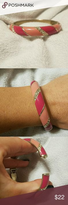 Adorable austrian crystal pink enamel cuff bracele This bracelet is so adorable. Filled with austrian crystals and painted pink enamel detail,this bracelet is a very unique addition to any jewelry collection. The gold plated cuff bracelet is made of top quality and has a very secure snap spring closure. Bracelet is pre owned and in very good condition with only minor signs of wear. Simular  bracelets sell for $62. Jewelry Bracelets