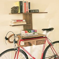 Description: A stylish shelving solution designed to display/store your bicycle as well as a collection of favorite books, knickknacks or plants. Indoor Bike Storage, Bicycle Storage, Bike Storage Apartment, Bicycle Hanger, Wall Mount Bike Rack, Range Velo, Bike Shelf, Shelving Solutions, Cool Inventions