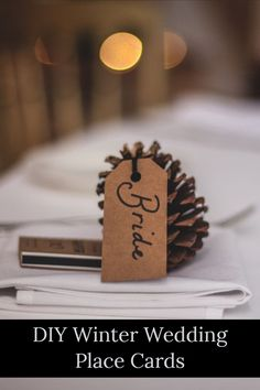 Need some earthy inspiration that won't break the bank for your winter weddings, parties and events? Simply gather pine cones in a variety of shapes and sizes. Make sure they'll sit flat on their bottom! Create name cards on heavy, recycled card stock with a thick, bold ink. Punch hole in card and affix to pine cone with twine, cord, string or raffia. Place one at each place setting and voila! You've got a perfect mix of bohemian and woodsy details. Great for holiday dinner parties, too! Wedding Advice, Wedding Planning Tips, Budget Wedding, Destination Wedding, Wedding Ideas, Diy Wedding, Wedding Meme, Wedding Planner, Wedding Hacks