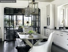 farmhouse kitchen.  white, lantern pendants, and amazing steel & glass doors.
