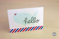 Greetings from WA state... or anywhere.  Personalize by placing the heart wherever you wish!  Stamps are from the A Muse Studio Wish You Were Here stamp set.  Hand-scripted 'hello' die is brand new and will be available on 3/1/14.  Postal washi tape is also available from A Muse. #amusestudio #handmadecard #cardideas #usamap