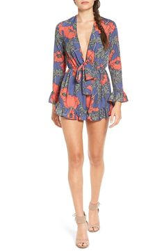 Swooning over this floral romper that features a plunging V-neckline and flirty ruffled edges.