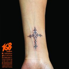 cross tattoo small on women wrist placement