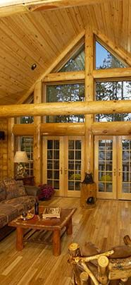 Awesome log home entry with high gable and lots of windows