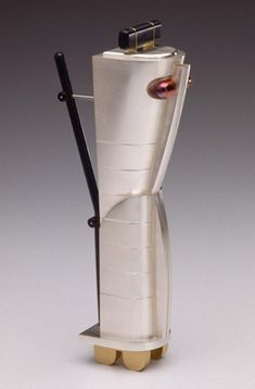 Tom Muir    Earth Mother - coffee server  sterling silver, 18k gold,   anodized aluminum (black),   oxidized copper (red)  1989