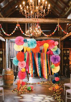 Bright backdrop for this bright rainbow wedding. Some of this wedding's info: Photos: Lara Hotz, Cinematography: The White Tree, Bridal gown + Veil: Jane Hill, Pom-pom crown handmade with pom-pom from iammie, via Etsy, Shoes: Ebony M, Flowers: The Sisters.