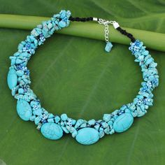 This beautiful beaded necklace by Nareerat is the perfect accent to any trendy look. Handcrafted with resin, dyed magnesite and glass, this Thai necklace gushes sky blue elegance.