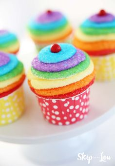 Easy Rainbow Cupcakes----adorable! Although, am I the only one who feels like that is a lot of frosting?!