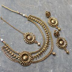 Gorgeous Design Necklace and earrings studded with Simulated Golden BeadGold Tone, handcrafted with high quality BeadEarrings - Measures (approx) 70mm(L) x 35mm(W) OR 2 3/4