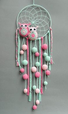 Crochet owls incorporated into a dreamcatcher. Great for a child*s bedroom.