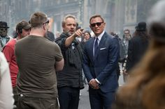 "Director Sam Mendes and Daniel Craig run through a scene on the set of ""Spectre"", 2015. James Bond Suit, Bond Suits, James Bond Movies, Grey Pinstripe Suit, Sharkskin Suit, Navy Overcoat, Daniel Craig 007, Herringbone Suit, Sam Mendes"
