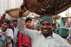 A porter at Gulshan Market in Dhaka where fruit and vegetables are sold.