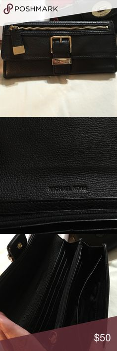Michael Kors wallet Black leather Michael Kors wallet. Used once! No imperfections. Like new! It's a beautiful well made MK wallet. MICHAEL Michael Kors Bags Wallets