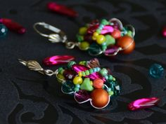Items similar to Teardrop shape beaded wirework earrings in green pink orange and yellow on Etsy Handmade Jewelry, Handmade Items, Unique Jewelry, Handmade Gifts, Statement Earrings, Stud Earrings, Wire Work, Beautiful Necklaces, Shapes
