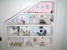 This is the dollhouse my husband and I created for my daughter's 2nd birthday.  It is built into the wall.  There is also a description of what we did and photos of each room.  Don't have a blog so I posted it on Project Nursery.