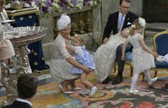 CP Victoria of Sweden, Princess Lenore of Sweden, Prince Daniel holding Prince Oscar, Princess Estelle. At Prince Oscar's christening. May 27 2017