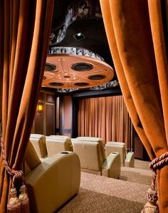 Home Theatre modern media room - I love the film reel made of family photos on the ceiling.