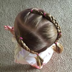 Fun simple braids pulled into low piggies. #toddlerhair #toddlerhairideas #toddlerstyle #easyhairstyle #toddler #buns #braids