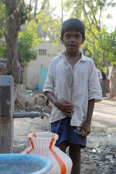 A boy fills a jug at a new water point in #India