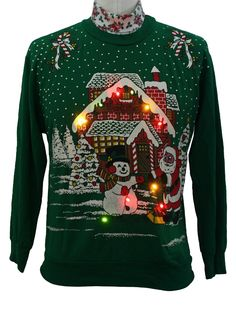 "Having an ""Ugly Christmas Sweater"" Party this year? I am! (This one lights up!) I want. 80s authentic vintage -Nutcracker- Unisex green background acrylic longsleeve pullover lightup ugly Christmas sweatshirt, candy cane turtleneck collar with Santa decorating his workshop with multi-colored Christmas lights. (made for a woman but would look swell on a guy as well, just scrunch up those sleeves if they are too short)"