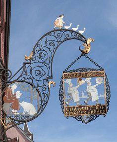 Shop sign, Alsace, Enseigne Hansi - Colmar by Office de Tourisme de Colmar, via Flickr