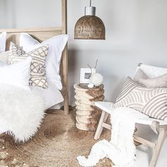 Our new Ripple Stool, Amarula Hanging Light, Cape Town Occasional Chair in white (perfect for undercover outdoors) and our Strand Four Poster Bed, in a reclaimed aged finish.