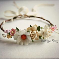 Welcome to Vintage Fairy  Lovely soft and delicate flowers are clustered on this sweet little flower crown White berries circle the crown.  The base of the crown is thick bark wire. Creams, pinks and white flowers feature on this crown along with sprays of cream pearls. Adjustable in the back with ribbon   Please message me with age of child for the correct size  Flower type may differ slightly depending on stock at time of ordering