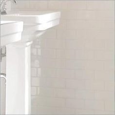 white subway to contrast the floors then a beautiful ribbon of glass tile through it.