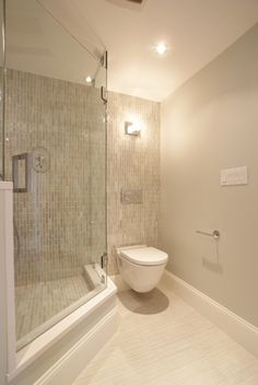 Shower right by toilet which is what we have going in our current arrangement.  This could work w/ full glass.