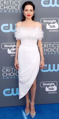 Angelina Jolie stunned in a white Ralph & Russo dress accented with fluffy feathers and a an asymmetric hemline for the Critics Choice Awards. Those classic pumps and the sparkly Neil Lane earrings were perfect accessories.