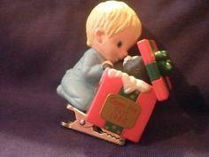 Hallmark Keepsake Ornament 1986 Baby opening gift clip on branch